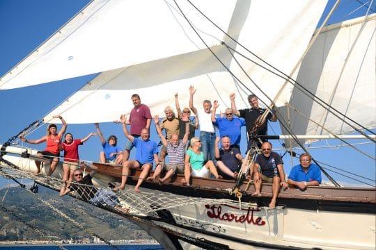 Florette waving guests bowsprit