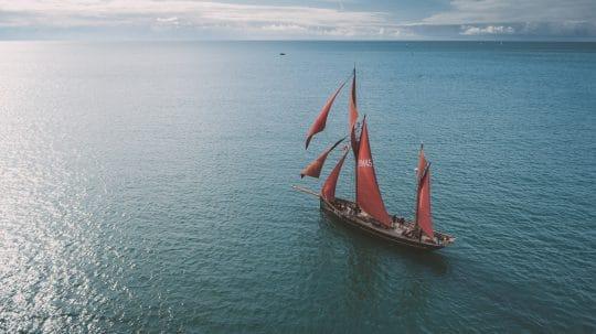 Pilgrim-aerial-fullsail-sea