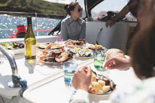 Stravaigin eating on deck