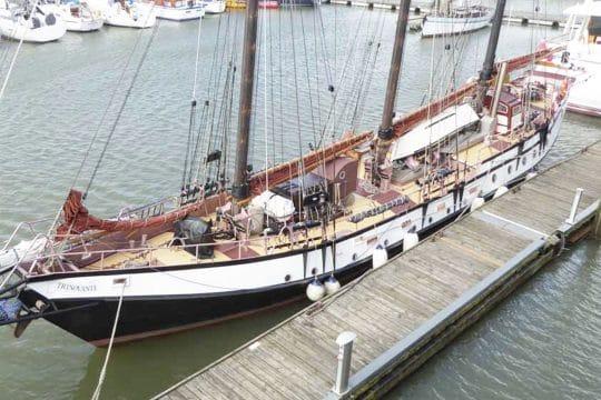 Trinovante moored sails down