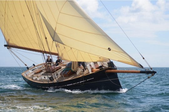 Unity cutter boat under sail
